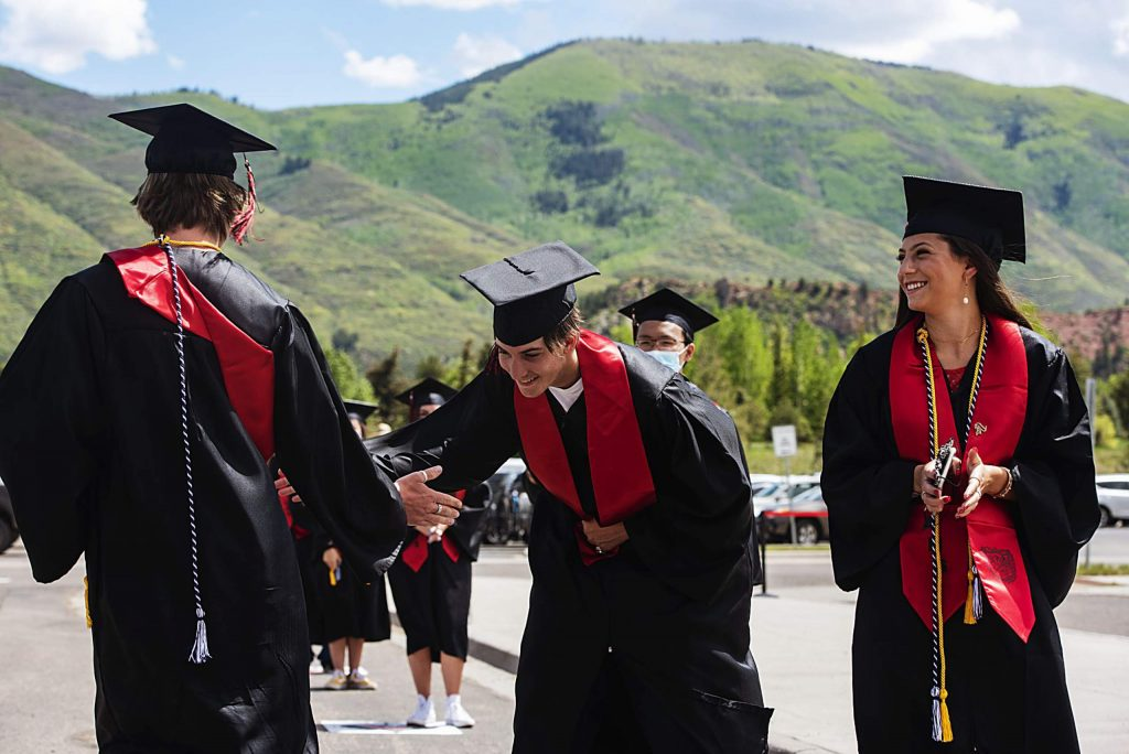 Graduates wait to cross the stage during Aspen High School's graduation ceremony at Buttermilk on Saturday, May 30, 2020. (Kelsey Brunner/The Aspen Times)
