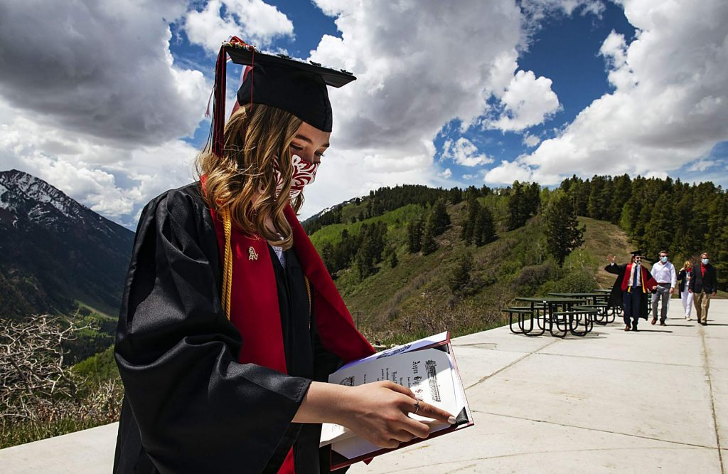 Kyndal Ferrell puts her official diploma inside of her holder at Cliffhouse during Aspen High School's graduation at Buttermilk on Saturday, May 30, 2020. (Kelsey Brunner/The Aspen Times)