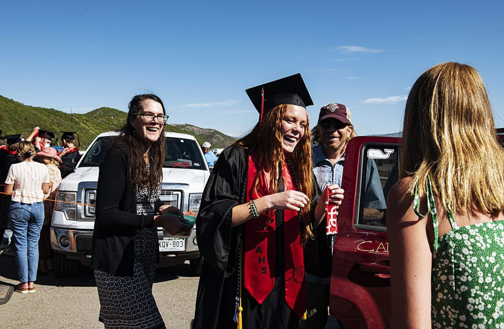 Graduate Maeve McGuire prepares for the Aspen High School's graduation ceremony at Buttermilk on Saturday, May 30, 2020. (Kelsey Brunner/The Aspen Times)