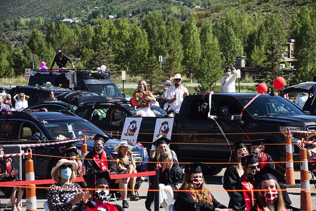 Graduates and family watch the Aspen High School's graduation ceremony from the parking lot at Buttermilk on Saturday, May 30, 2020. (Kelsey Brunner/The Aspen Times)
