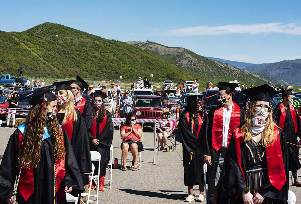 Graduates stand at the beginning of the Aspen High School graduation ceremony at Buttermilk on Saturday, May 30, 2020. (Kelsey Brunner/The Aspen Times)