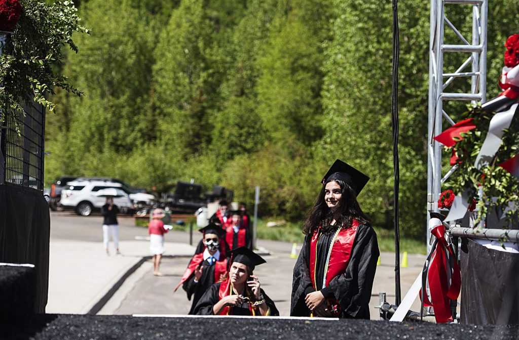 Graduates line up as the Aspen High School graduation ceremony begins at Buttermilk on Saturday, May 30, 2020. (Kelsey Brunner/The Aspen Times)