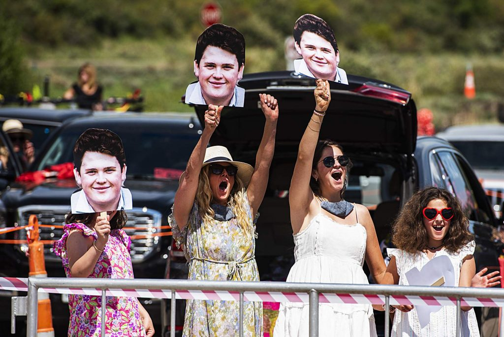 Jack Halferty's family cheer for him as he crosses the stage during Aspen High School's graduation at Buttermilk on Saturday, May 30, 2020. (Kelsey Brunner/The Aspen Times)