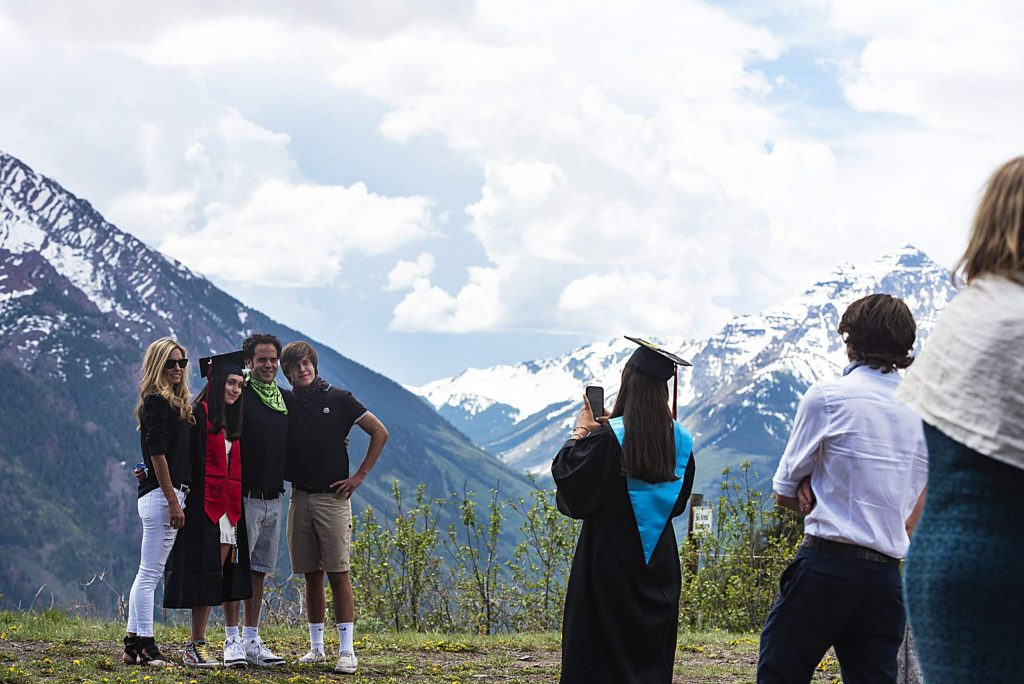 Families take photos in front of Pyramid Peak after Aspen High School's graduation at Buttermilk on Saturday, May 30, 2020. (Kelsey Brunner/The Aspen Times)