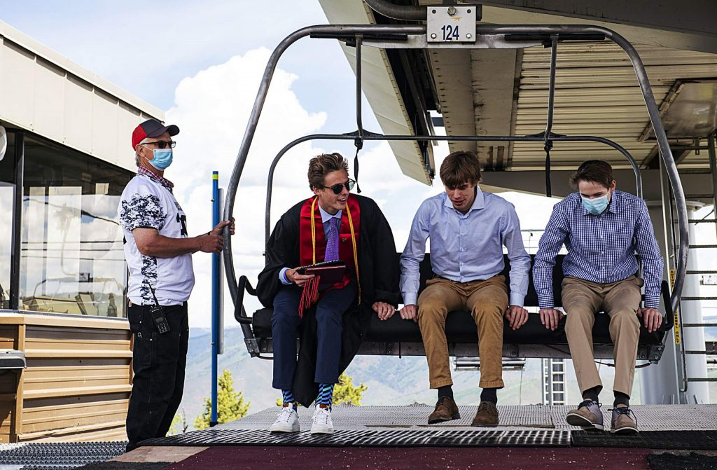 Graduate Connor Chesner, center left, and his family get off the Summit Express lift at the top of Buttermilk during Aspen High School's graduation at Buttermilk on Saturday, May 30, 2020. (Kelsey Brunner/The Aspen Times)