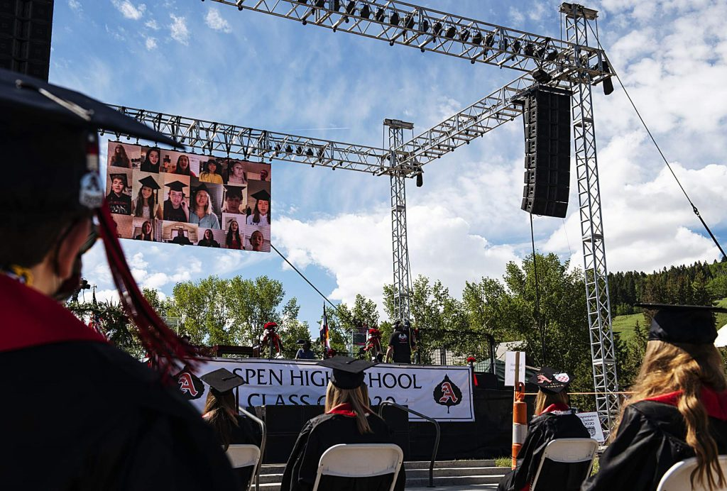 Graduates watch a virtual choir performance during Aspen High School's graduation ceremony at Buttermilk on Saturday, May 30, 2020. (Kelsey Brunner/The Aspen Times)