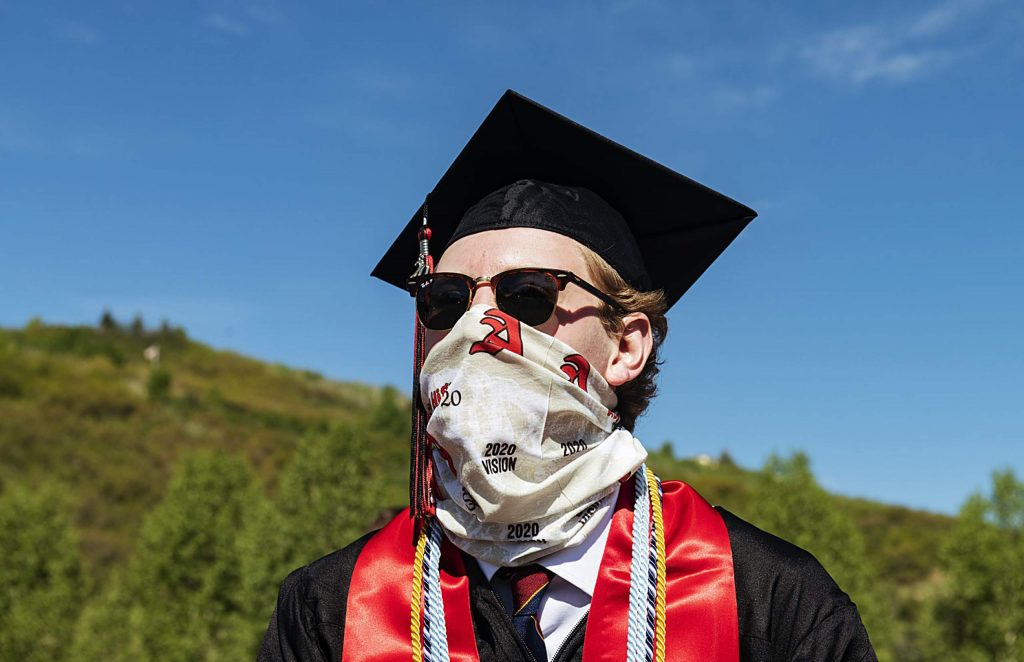 A graduate wears an Aspen High School buff during the graduation ceremony at Buttermilk on Saturday, May 30, 2020. (Kelsey Brunner/The Aspen Times)