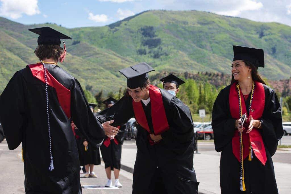 Graduates wait to cross the stage during Aspen High School's graduation ceremony at Buttermilk on Saturday, May 30, 2020.