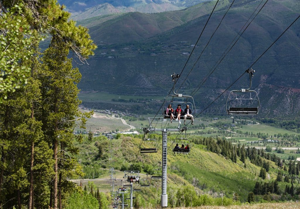 Graduates ride the Summit Express lift to the top of Buttermilk after the official Aspen High School graduation ceremony at Buttermilk on Saturday, May 30, 2020.