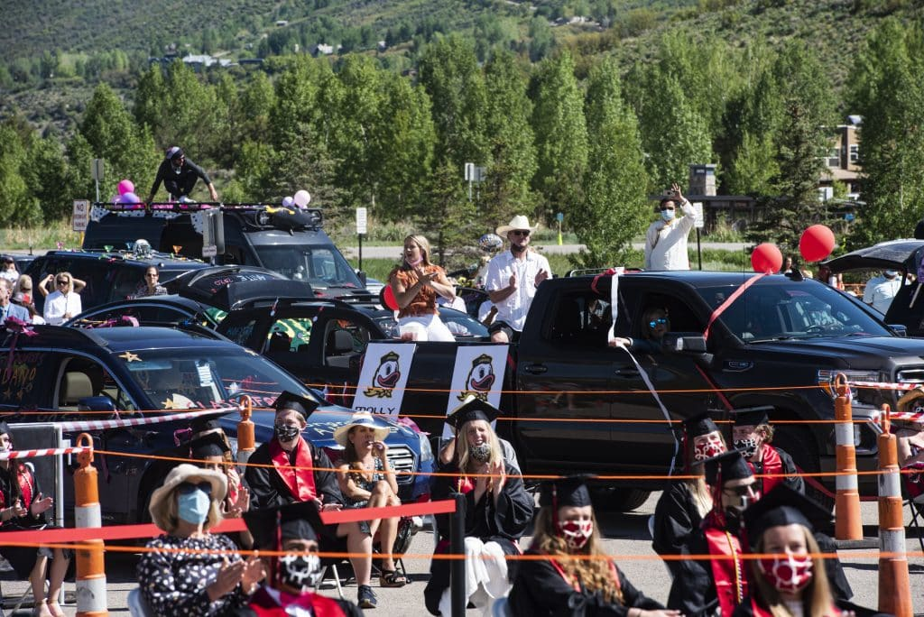 Graduates and family watch the Aspen High School's graduation ceremony from the parking lot at Buttermilk on Saturday, May 30, 2020.