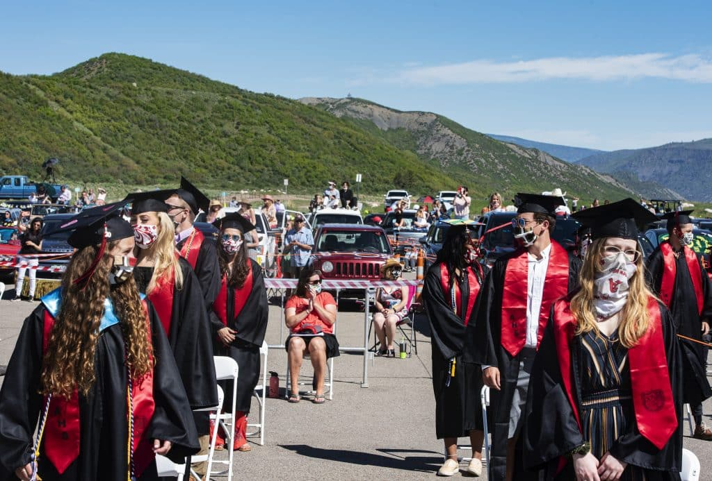 Graduates stand at the beginning of the Aspen High School graduation ceremony at Buttermilk on Saturday, May 30, 2020.