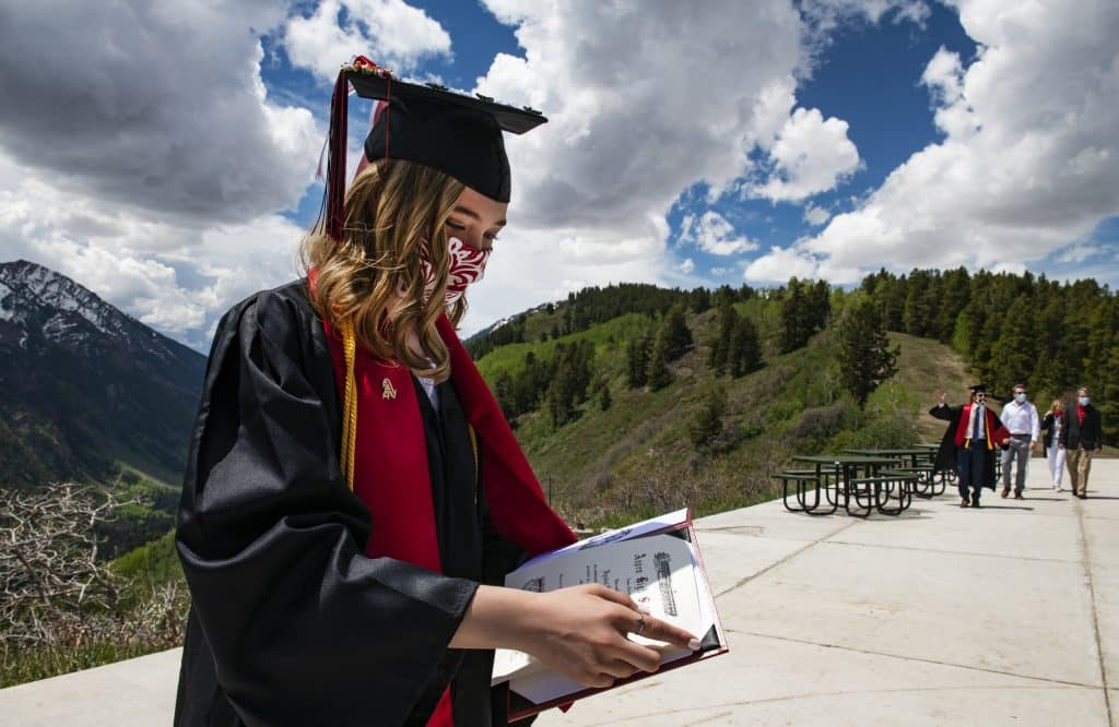 Kyndal Ferrell puts her official diploma inside of her holder at Cliffhouse during Aspen High School's graduation at Buttermilk on Saturday, May 30, 2020.