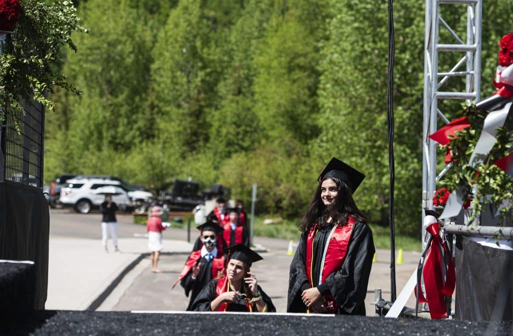 Graduates line up as the Aspen High School graduation ceremony begins at Buttermilk on Saturday, May 30, 2020.