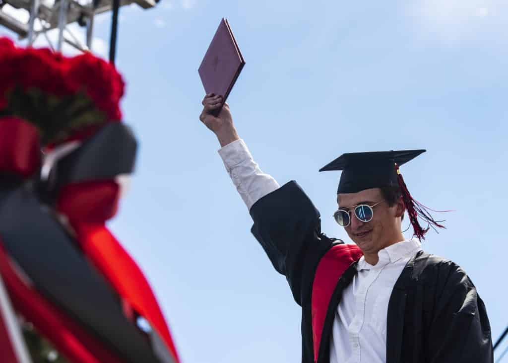 A graduate crosses the stage during Aspen High School's graduation ceremony at Buttermilk on Saturday, May 30, 2020.