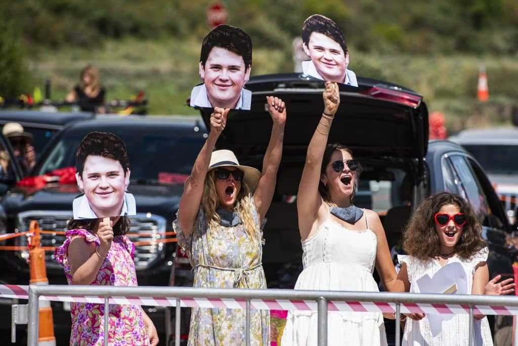 Jack Halferty's family cheer for him as he crosses the stage during Aspen High School's graduation at Buttermilk on Saturday, May 30, 2020.