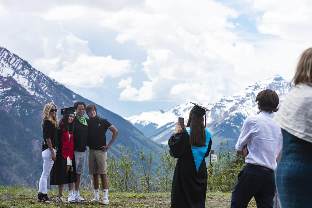 Families take photos in front of Pyramid Peak after Aspen High School's graduation at Buttermilk on Saturday, May 30, 2020.