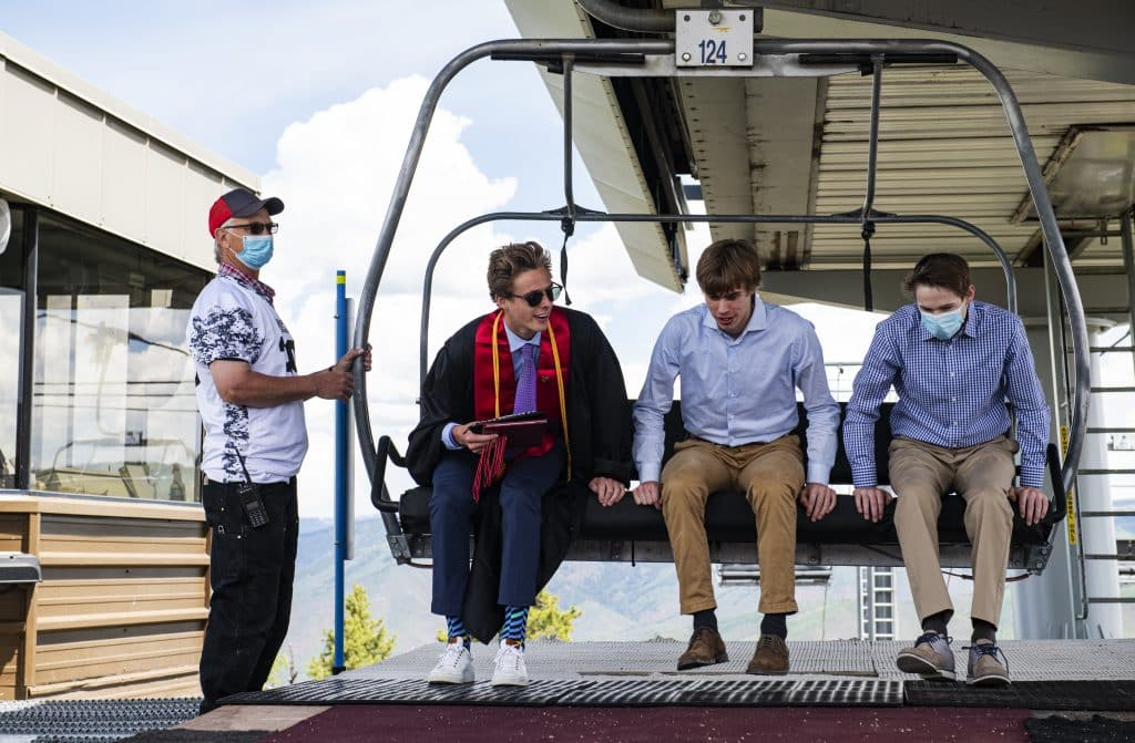 Graduate Connor Chesner, center left, and his family get off the Summit Express lift at the top of Buttermilk during Aspen High School's graduation at Buttermilk on Saturday, May 30, 2020.