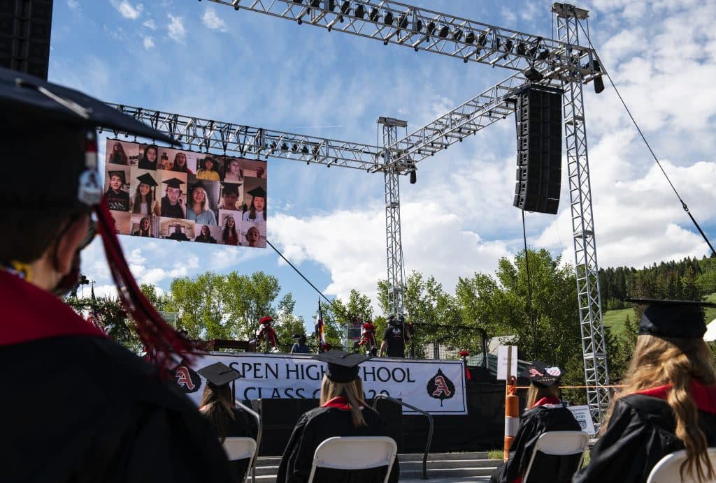 Graduates watch a virtual choir performance during Aspen High School's graduation ceremony at Buttermilk on Saturday, May 30, 2020.