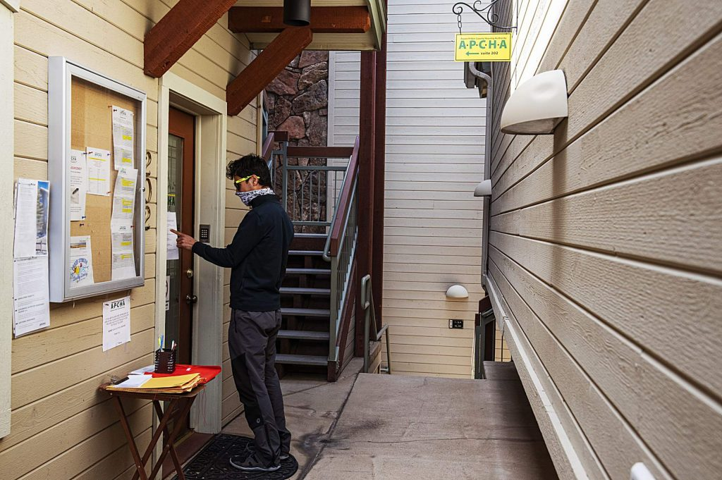 Ravi Maharjan reads the sign on the door of the APCHA office in Aspen on Tuesday, May 5, 2020. Maharjan was hoping to apply for an APCHA rental property. (Kelsey Brunner/The Aspen Times)