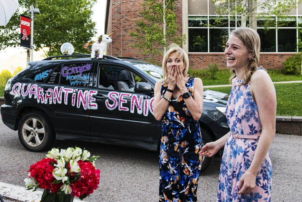 """Pixie Witt, left, reacts with excitement as the list of scholarships that her daughter Morgan Witt was awarded are announced at the scholarship drive-through event on the Aspen School District campus on Thursday, May 28, 2020. """"It's amazing,"""" said Pixie about her daughter's scholarships. """"It's been a long four years and it's a great success."""""""