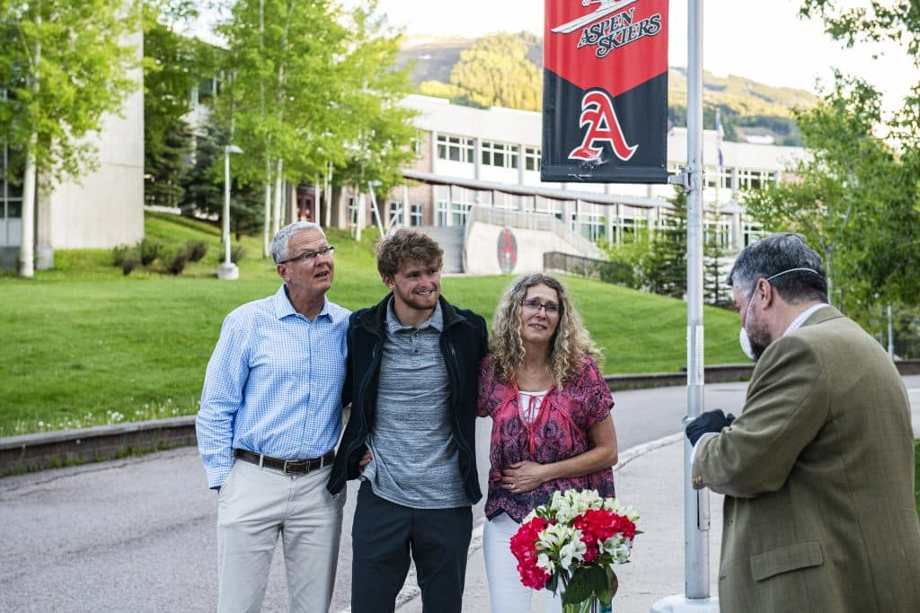 Jonathan Woodrow and his family react as he's presented as one of the two male athletes of the year at Aspen High School on Thursday, May 28, 2020.