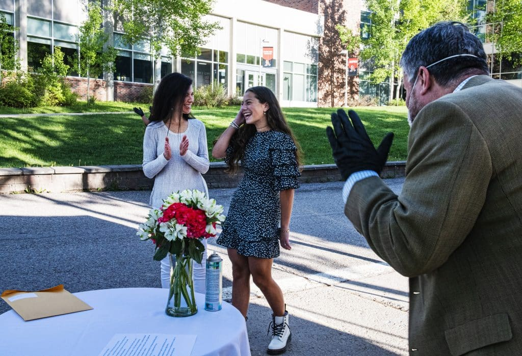 Louise and Shira Lipsey react as Louise is awarded scholarships during Aspen High School's drive-through event on Thursday, May 28, 2020.