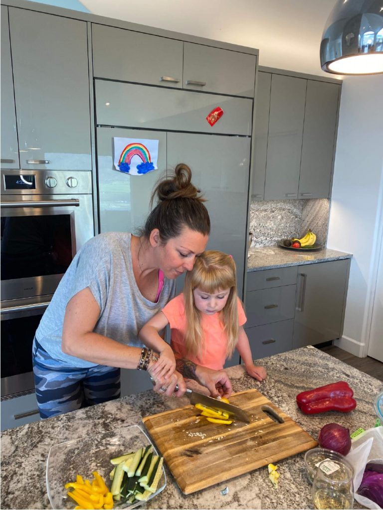 Kids Fit Kitchen founder Sara Broome with Madison-Grace Barbles.