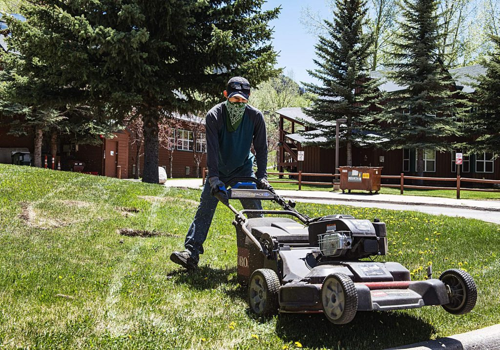 Alberto Garcia mows the grass at Marolt Ranch Housing in Aspen on Monday, May 18, 2020. (Kelsey Brunner/The Aspen Times)