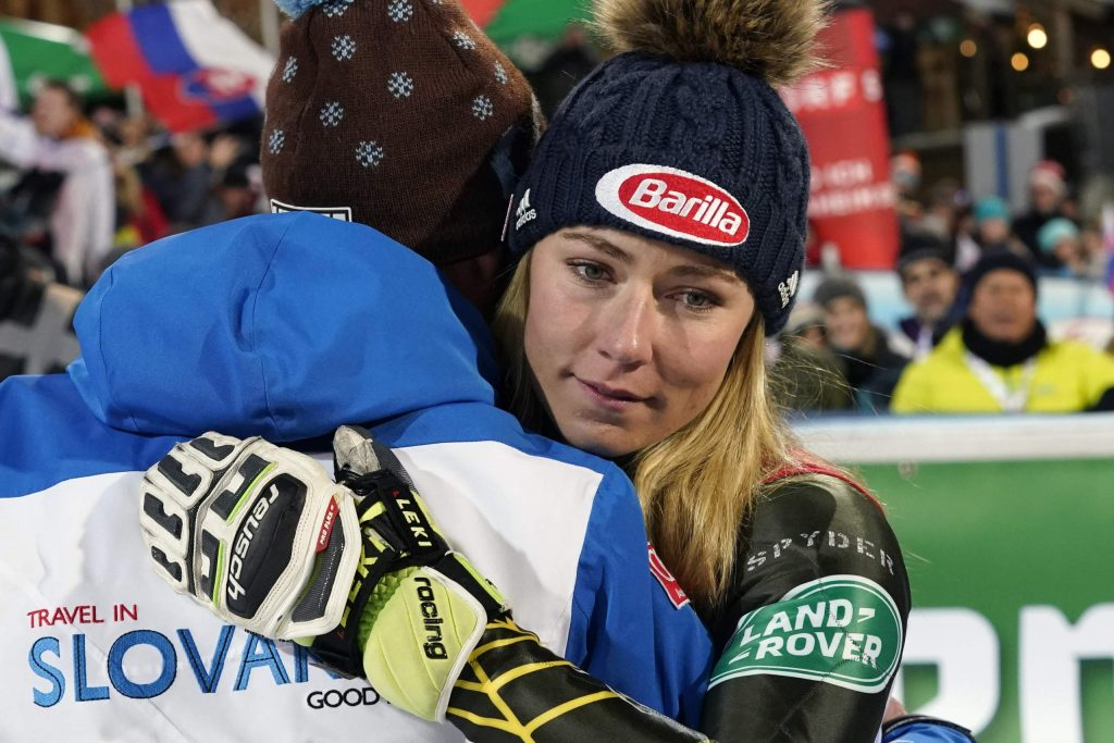 United States' Mikaela Shiffrin embraces Italy's Livio Magoni, coach of Slovakia's Petra Vlhova, after completing an alpine ski women's World Cup slalom race in Flachau, Austria. When she's not winning races, two-time Olympic champion Mikaela Shiffrin unplugs by singing and playing guitar. Music was always a bond she shared with her late father, Jeff, who died on Feb. 2 after an accident at his home in Edwards.