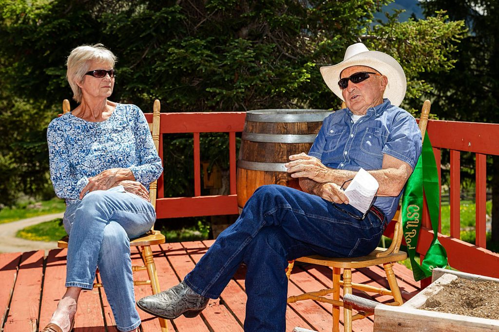 Susy and George Culbreath sit on the porch of their ranch in Heeney and engage in conversation on Saturday, May 30. George is a recent inductee into the Rodeo Hall of Fame.