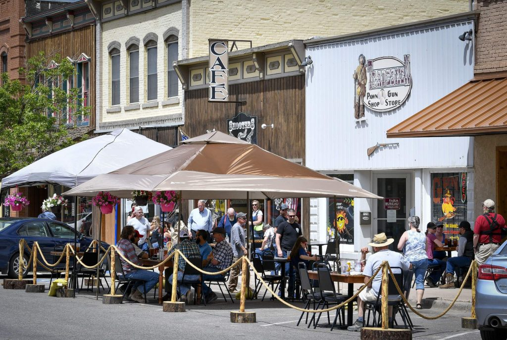 In defiance of a cease and desist order and temporary court-issued restraining order Shooters Grill in Rifle was open for business May 14, serving customers outside the Third Street restaurant.