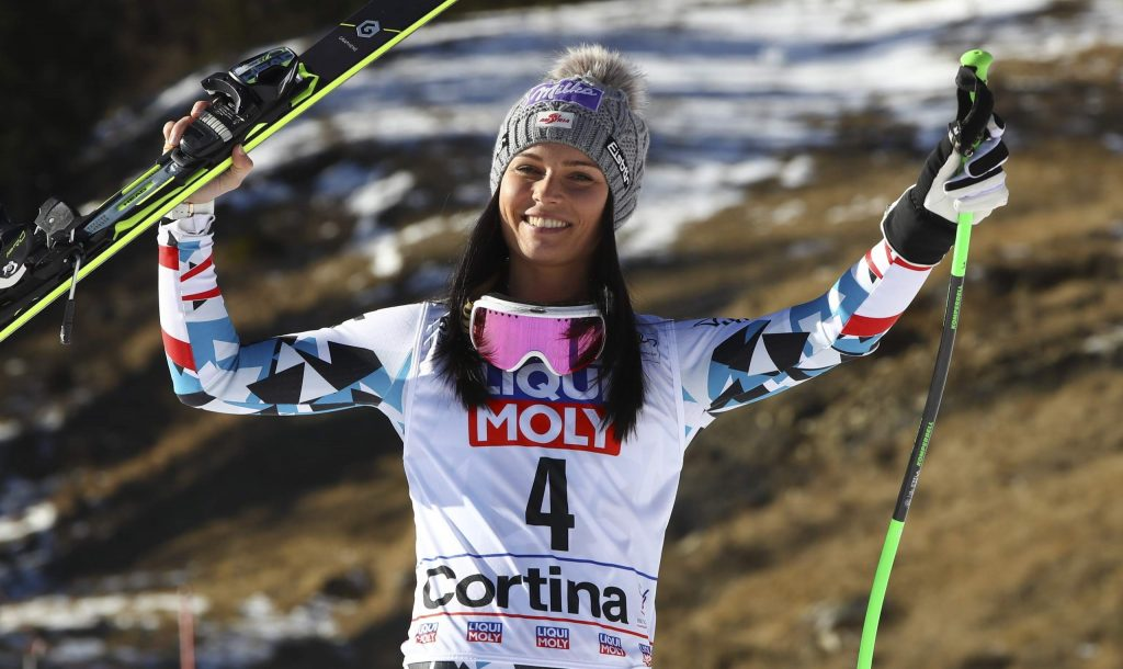 FILE - In this Jan. 29, 2017, file photo, Austria's Anna Veith celebrates her third place finish in the in the women's World Cup super-G ski race in Cortina d'Ampezzo, Italy. Veith, who twice returned to the top from serious knee injuries but called it a career a year after blowing out her knee for the third time, announced her retirement Saturday, May 23, 2020.(AP Photo/Alessandro Trovati, File)