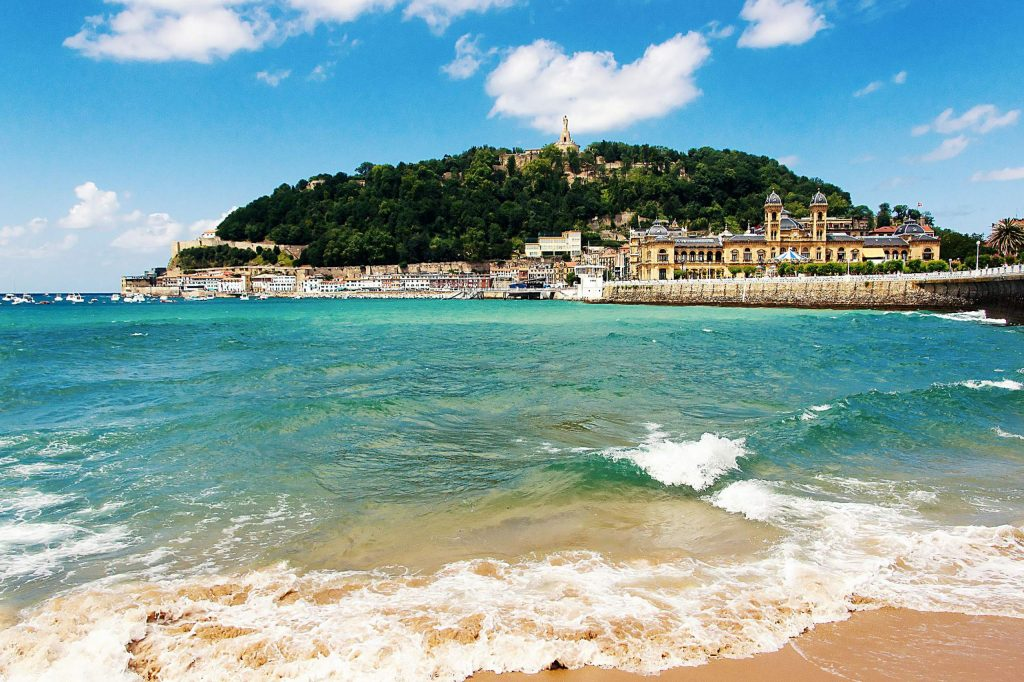 View of sandy beach of San Sebastian (Donostia), Spain in a lovelyl summer day. San Sebastian is one of the most famous tourist destinations in Spain
