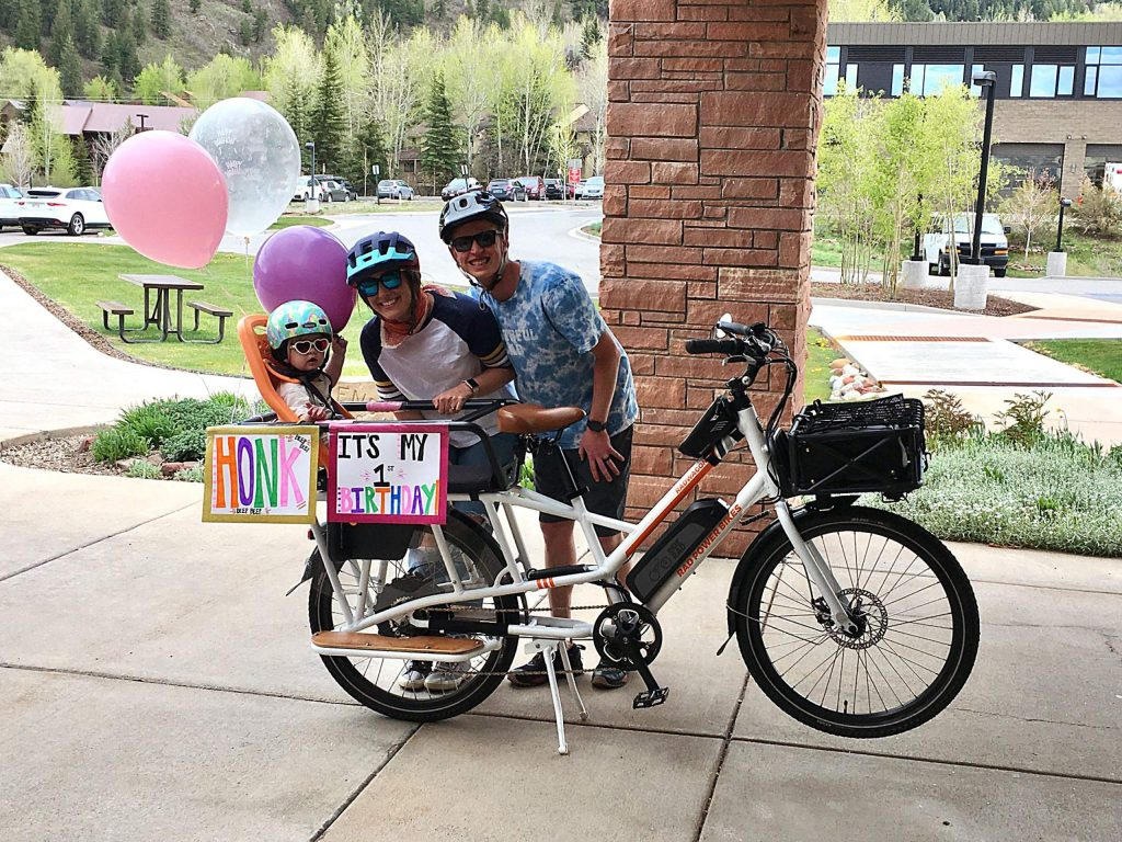 Aspen resident Murphy McBride celebrated her first birthday on May 12 on the back of her parents' bicycle, also letting onlookers know it was party time. Her father, Taylor, said they decked out the bicycle with signs, balloons, and dragged around plastic bottles, similar to a just-married vehicle.