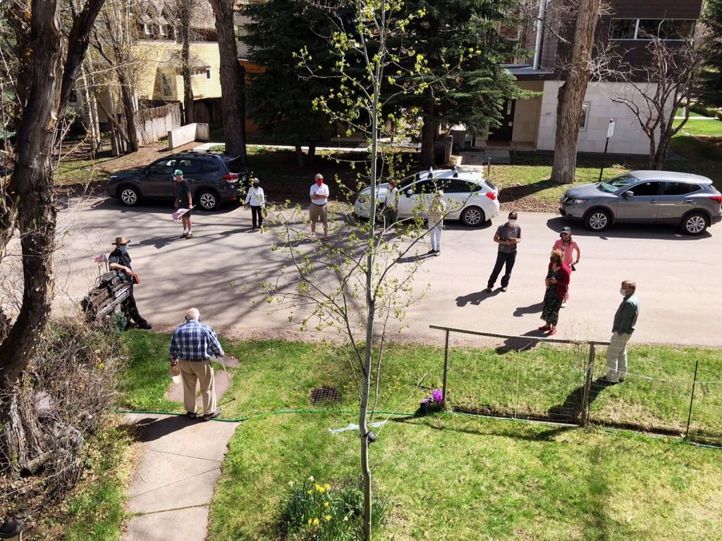 Jim Markalunas has lived in the same house in Aspen's West End neighborhood for 63 years, and he had plenty of well-wishers celebrating while keeping their distance on his 90th birthday on the afternoon of March 3. Jim, wearing a plaid shirt, is pictured near the edge of his sidewalk.