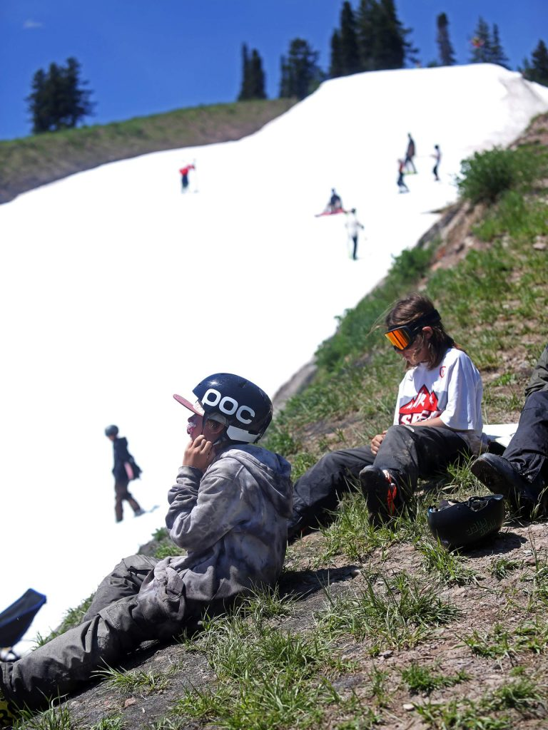 Young athletes hang out during the AVSC Buttermilk Glacier camp on Tuesday, June 26, 2018, at Buttermilk Ski Area. (Photo by Austin Colbert/The Aspen Times).