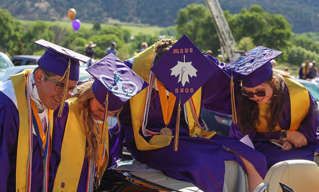 Basalt High School Class of 2020 graduates pose for a photo of the tops of their caps on May 30, 2020. (Maddie Vincent/The Aspen Times)