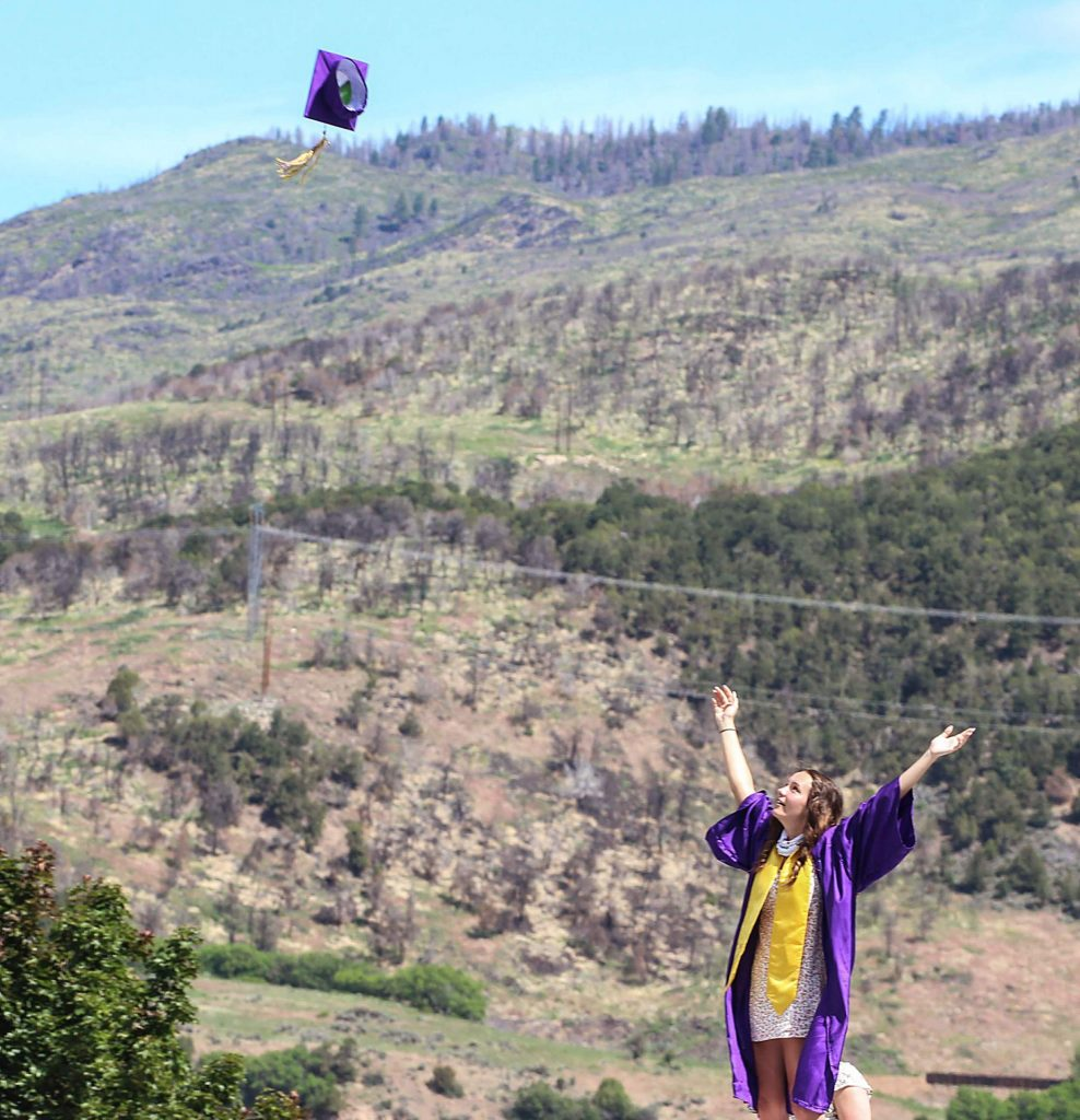A Basalt senior throws up her cap after the Class of 2020 graduation ceremony on May 30, 2020. (Maddie Vincent/The Aspen Times).