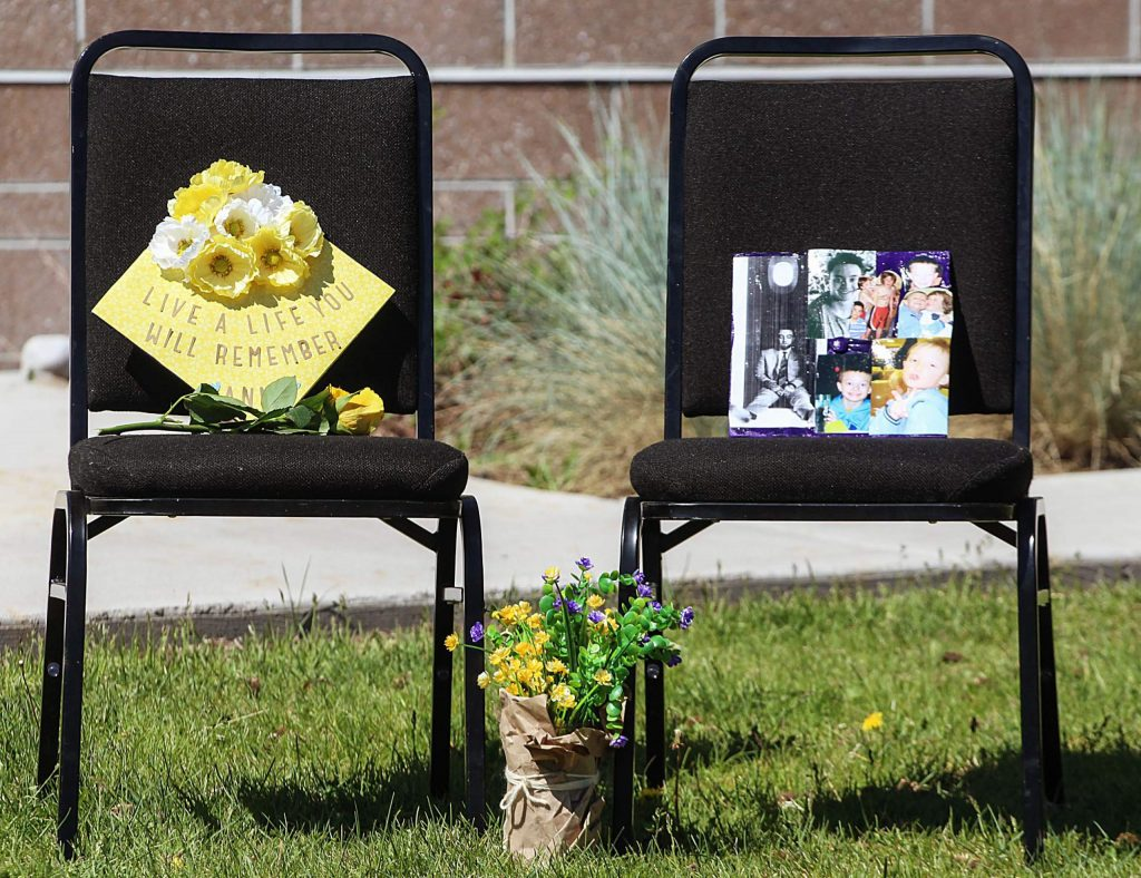 Graduation caps in memory of Anna Cunningham and Tyler Ribich sit on chairs near the stage of the Basalt High School Class of 2020 graduation ceremony on May 30, 2020. Both Cunningham and Ribich were chosen by their classmates for the school's Wall of Fame. (Maddie Vincent/The Aspen Times).