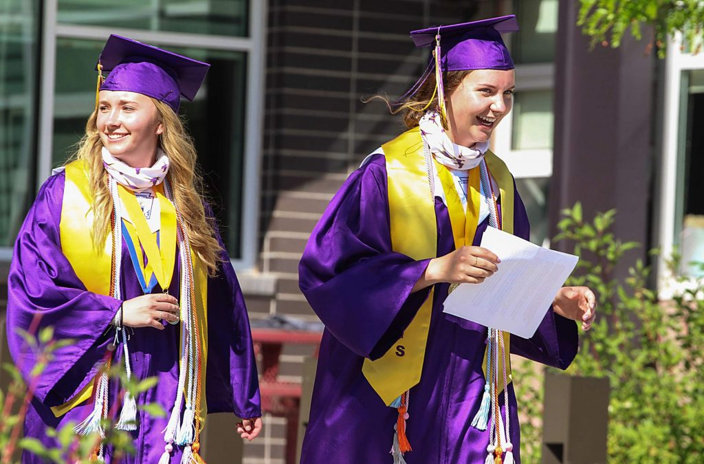 Anne Schrock and Sasha Brucker smile and laugh after giving their valedictorian speeches at the Basalt High School Class of 2020 graduation ceremony on May 30, 2020. (Maddie Vincent/The Aspen Times).