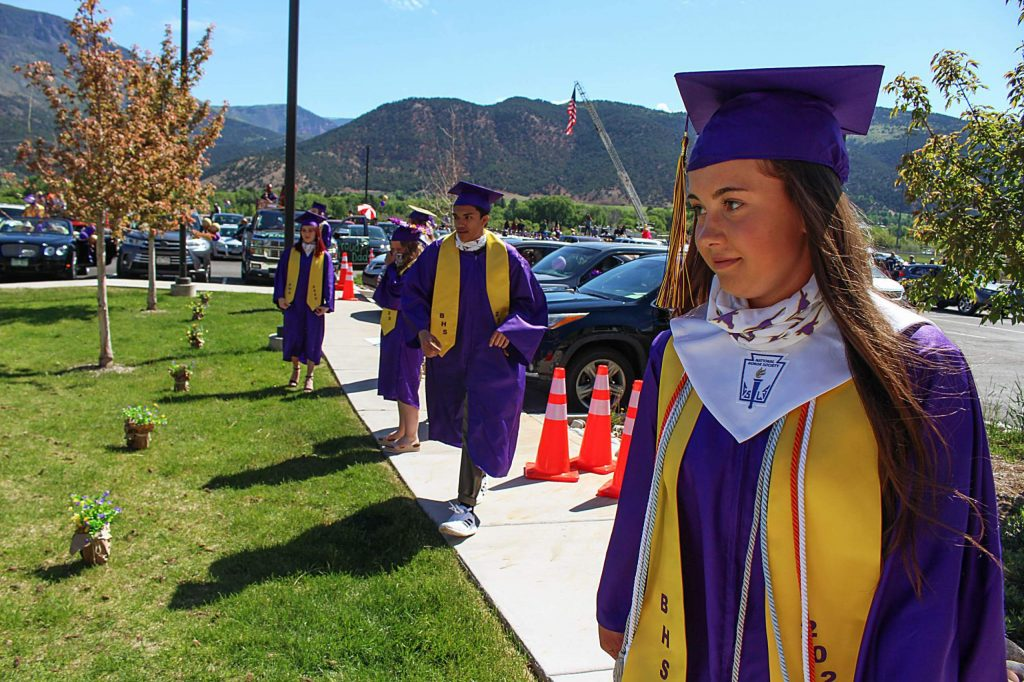 Basalt seniors line up 6 feet apart to get their diplomas on May 30, 2020. (Maddie Vincent/The Aspen Times).