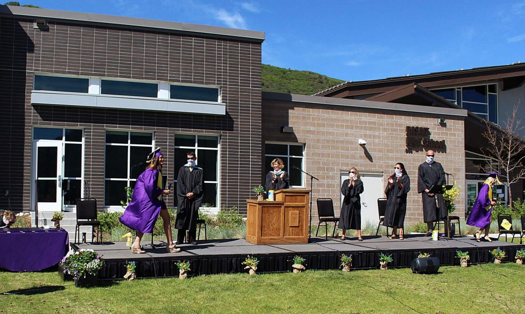 Basalt High School Class of 2020 seniors bump elbows with their administrators and teachers after receiving their diplomas on May 30, 2020. (Maddie Vincent/The Aspen Times).