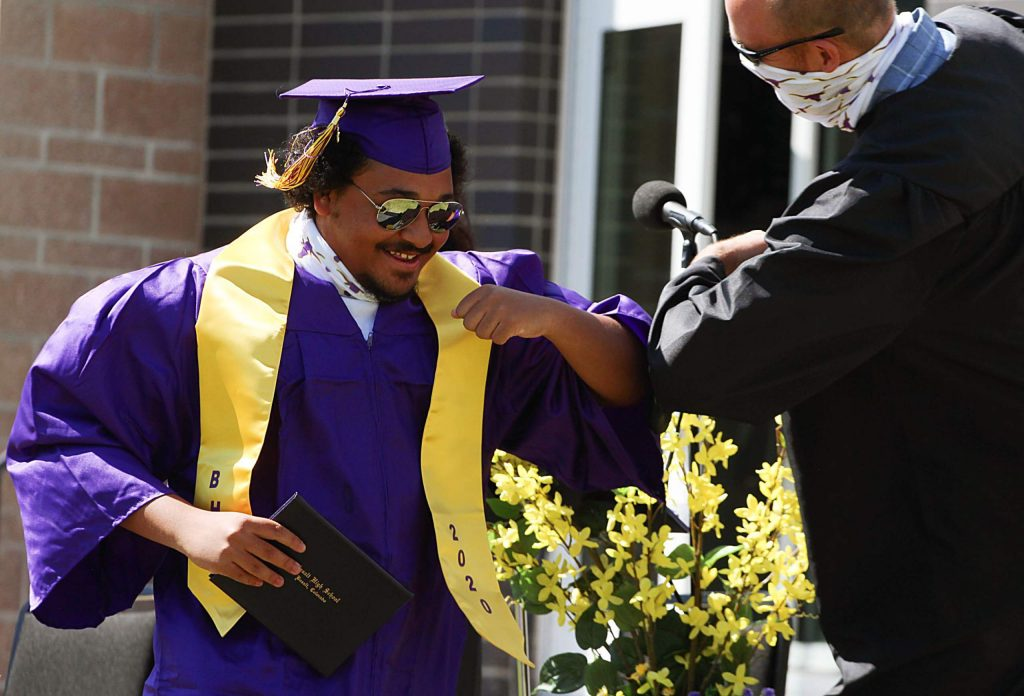 Seniors bump elbows with Basalt High School teachers on May 30, 2020. (Maddie Vincent/The Aspen Times).