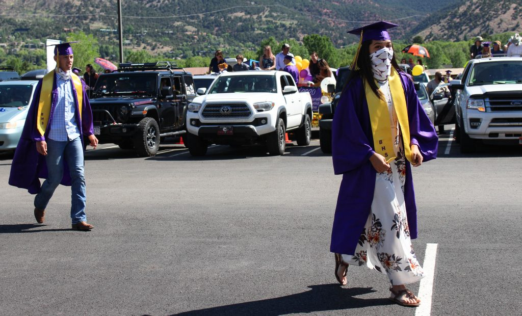 Basalt seniors walk up to the stage in front of the high school to collect their diplomas on May 30, 2020.