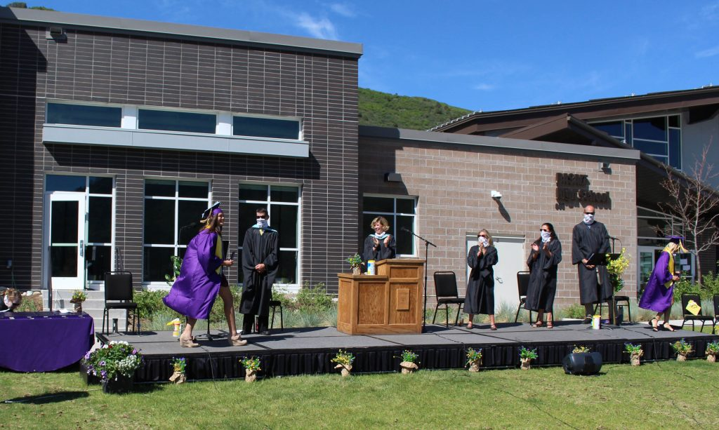 Basalt High School Class of 2020 seniors bump elbows with their administrators and teachers after receiving their diplomas on May 30, 2020.