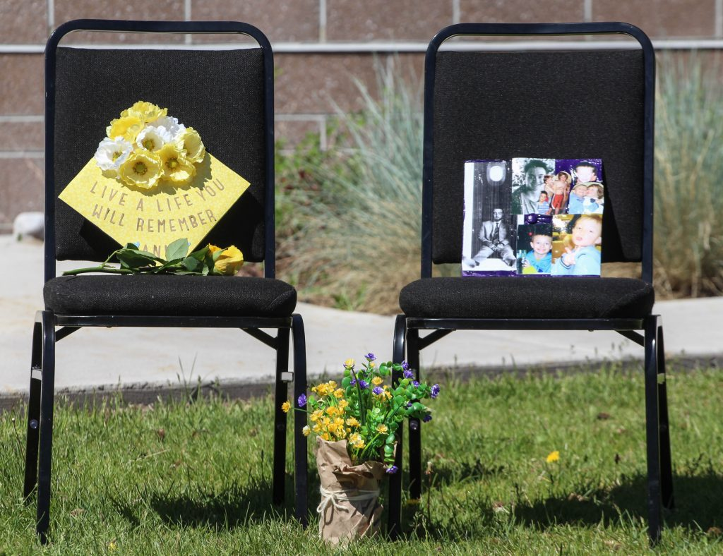 Graduation caps in memory of Anna Cunningham and Tyler Ribich sit on chairs near the stage at the Class of 2020 graduation ceremony May 30, 2020. Both Cunningham and Ribich were chosen by their classmates for the school's Wall of Fame.