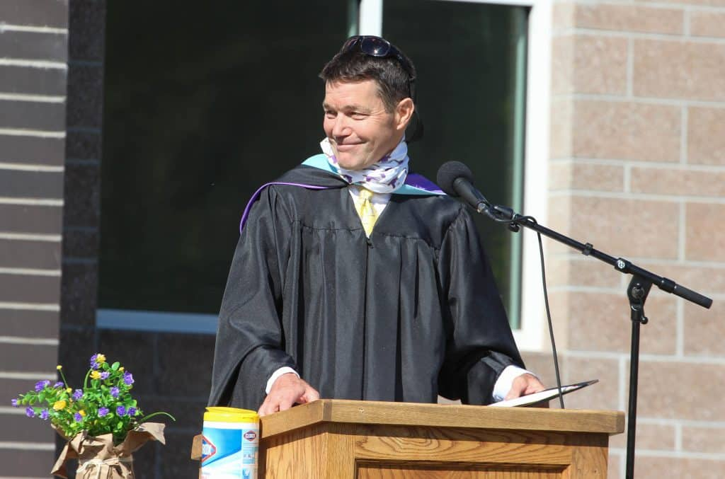 Basalt High School Principal Peter Mueller smiles after addressing seniors and their families at the Class of 2020 graduation ceremony May 30, 2020.