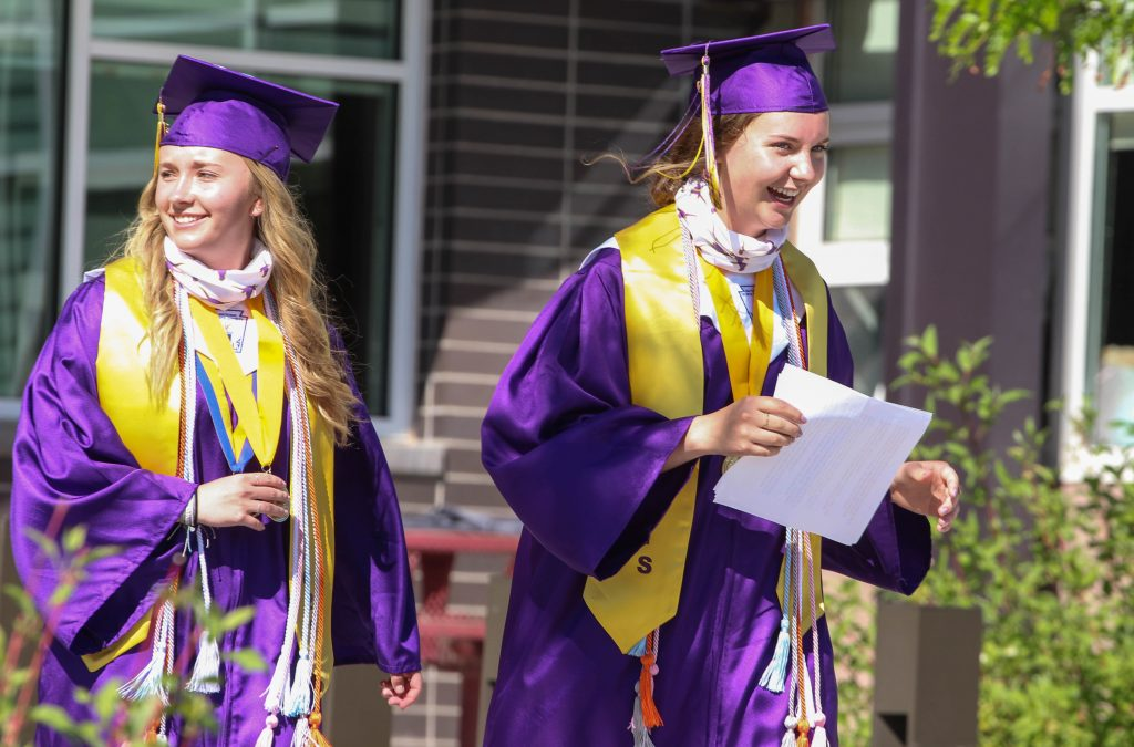 Anne Schrock and Sasha Brucker smile and laugh after giving their valedictorian speeches at the Basalt High School Class of 2020 graduation ceremony on May 30, 2020.