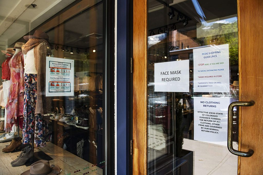 Safety guidelines for shoppers hang in the front door of Pitkin County Dry Goods in Aspen on Friday, May 29, 2020. (Kelsey Brunner/The Aspen Times)