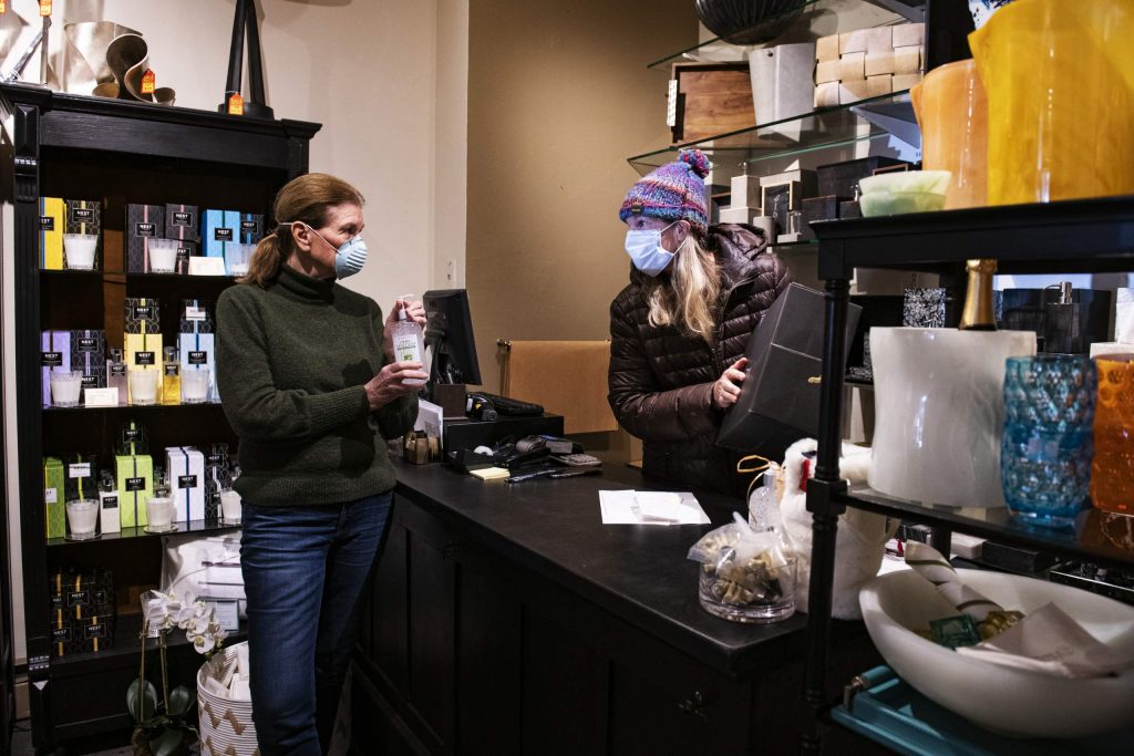 Chequers owners Becky Dumeresque, left, and Ashley Ward work in the closed shop in Aspen on Friday, April 24, 2020. (Kelsey Brunner/The Aspen Times)